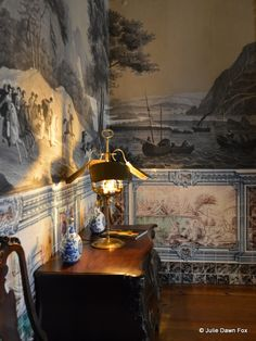 Scenic wallpaper and colourful painted wall tiles, reception hall of Casa da Ínsua hotel, central Portugal