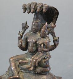 Lot 90 - LAKSHMI NARAYANA Tamil Nadu, South India, 18th century bronze, the four-armed Vishnu seated in