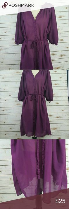 Sheer mauve dress/ cover up Versatile dress/ cover up with braided rope belt. Button detail on half sleeves. Two pockets on either side of waist. Looks great as a bathing suit cover up or with leggings. Sizing says small, but runs Large. 100% polyester. No snags. Dresses