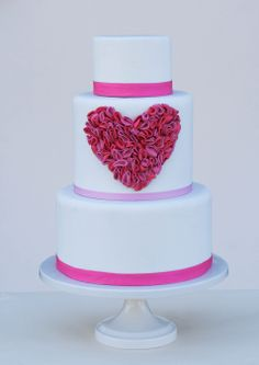 - Two-toned ruffled fondant heart on white fondant with grosgrain ribbon. Perfect for Valentine's Day, but absolutely adorable any time of the year too.