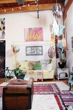 Bohemian Style Room Décor. Mix of rugs, pillows, colors, & patterns. -Kelly Rae Roberts: Soul Shine Studio Tour