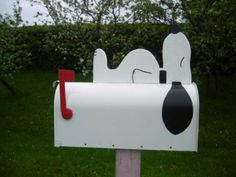 Snoopy! :) Maybe someday when we have a house... it'd be cute to have a red mailbox!