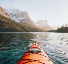 Kayaking through the sunset  / Saint Mary Lake Montana USA /  Alex Strohl Say Yes To Adventure