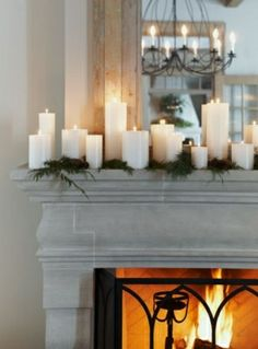 Christmas mantle, diff size candeks in fire place