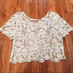 Express Lace Crochet Crop Top Express crop top. Lace crochet. Off white/ beige color. The tag is cut off bc it was super noticeable, but the product code is still visible. Size small but loose fitting. Super cute and fashionable for the spring and summer. Worn a few times, in great condition. Express Tops Crop Tops