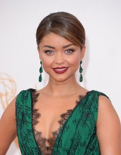 Pin for Later: 9 Reasons Sarah Hyland Is the Prettiest Teen Choice Awards Host Yet She can get gorgeously glam. At the 2013 Emmys, Sarah pinned her hair back to showcase a va-va-voom Cabernet-hued lip, keeping the rest of her face relatively bare.