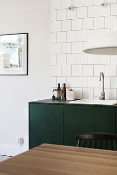 the green cabinets / kitchen