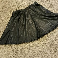 **faux leather skirt black Gently worn, still good conditon. best fits a small **f21 brand Forever 21 Skirts Mini