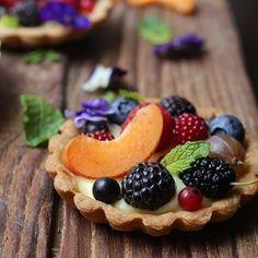 Fresh Fruit Tartlettes. #foodwinewomen #huffposttaste #nytc #desserts #sweets #wineberries #berries #instagood #howissummer #tarteauxfraises #tarteauxfruits #tartelettes #tartlettes