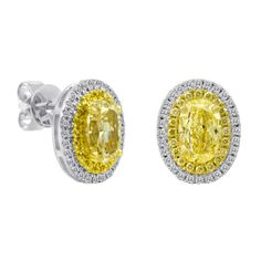 First Image Design stud earrings in 18k white and yellow gold with fancy yellow…