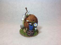 Bunny house in a walnut shell by Loredana Tonetti.