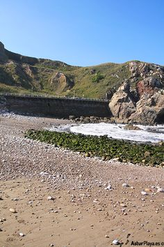 Western side of El Cuerno beach in Asturias, Spain - looks like an ordinary beach, smells like one, feels like one - the only surprise is that it shelters the remains of a 400 million years old reef. I saw it and so can you!