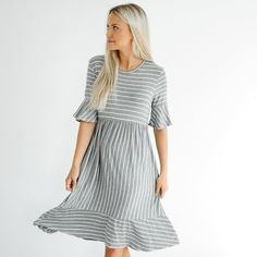 This is going to be your favorite Spring dress! It has the prettiest flowy look and a ruffle at the end of the sleeve and at the hem that makes it so feminine. It also has stripes which is such a fun added detail!