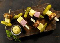 Cuban on a stick (serve with dijon and whiskey port mustard). Use extra old cheddar. Make 20 of these.