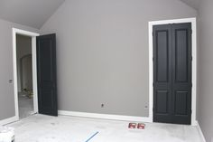 Gray walls, white trim, black doors by queen House Design, Black Interior Doors, House, Grey Walls White Trim, Home Projects, Home Remodeling, New Homes, Doors Interior, Home Construction