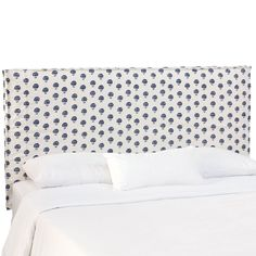 Made of a wood frame with cushiony fill, this Skyline Furniture Slipcover Headboard gives your bed frame a complete look. This hand flora indigo headboard features polka dot detailing that makes this headboard an exciting focal point of any bedroom.