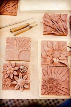 Students will be able to create a tile relief sculpture using carving and applique techniques. Mudworks Pottery: New Wall Plaques - flowers, flowers, flowers-- great idea using carving and applique techiniques to created nature inspired tiles Ceramics Projects, Clay Projects, Clay Crafts, Ceramics Ideas, Clay Tiles, Ceramic Clay, Ceramic Tile Art, 3d Tiles, Slab Pottery