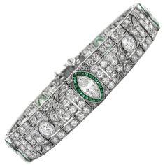 Art Deco Platinum, Diamond and Emerald Bracelet | From a unique collection of vintage retro bracelets at https://www.1stdibs.com/jewelry/bracelets/retro-bracelets/