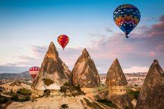 Hot+air+balloon+flying+over+Cappadocia,+Turkey
