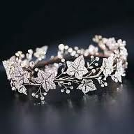 A fine 19th century diamond tiara, by Garrard & Co., designed as a full circle of old-cut diamond ivy leaves, with diamond single-stone collet berries, mounted in silver and gold, the seven principal leaves detachable for brooch conversion, leaves circa 1860, the collets added circa 1900, diamonds in excess of 100 carats, in a red leather case, stamped R & S Garrard & Co.