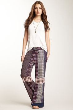 Scarf Print Pants. It's fun to opt for flowey patterned pants for a music fest!