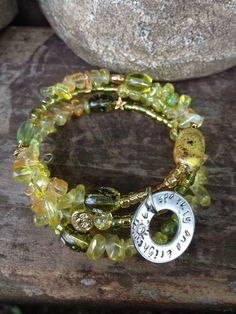 Be Sparkly and Bright: three wrap memory wire bracelet with metal stamped charm on Etsy, $30.00