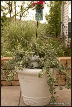 Painting polyurethane foam planters.  Lowe's Creative Ideas