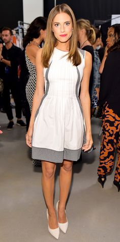 Allison Williams took her front row seat the DVF spring/summer 2015 show at NYFW in a gingham-accented LWD from the new collection and white pumps. #InStyle