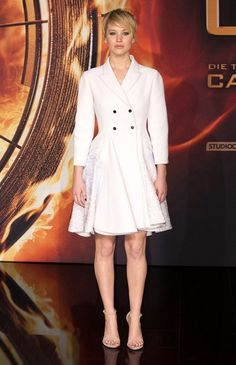 Jennifer Lawrence made a very classy choice with this double-breasted white Christian Dior coat when she attended the 'Catching Fire' Berlin premiere. Brand: Christian Dior