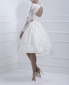 I could actually just buy this oneLong Sleeve lace Party dress short wedding dress lace by VEILDRESS, $128.00