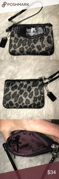 Coach 1941 Ocelot Sateen Wristlet Very stylish and unique! Gray background with black patent leather trim and Ocelot/leopard print. Excellent quality and condition, like new. Check out my other listings to bundle and save! Coach Bags Clutches & Wristlets
