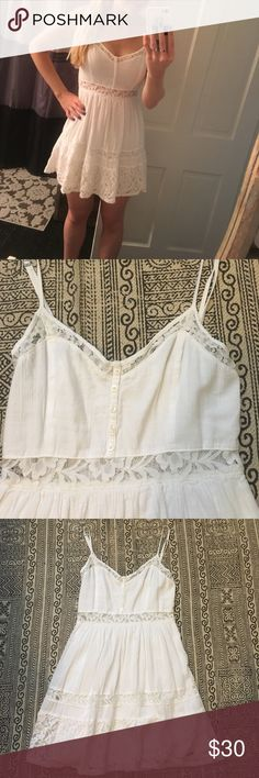 Abercrombie White Lace Dress Graduation This dress is perfect for summer or graduation! I've only worn this once and it was for my high school graduation. It has a lace see through piece in the stomach as you can see in the first picture, but it's adorable! Abercrombie & Fitch Dresses Mini