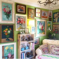 The floral gallery wall in my den. All paintings were from thrifts, yard sales, Etsy and eBay. The other walls are covered too! Via my Instagram account.
