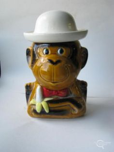 monkey with banana and white hat cookie jar