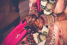 Bridal Details - Abhishek & Astha | WedMeGood | Mehendi with Bride and Groom Caricature, Colorful Pink and Orange Bangles  #wedmegood #indianbride #indianwedding #bangles #mehendidesign #mehendi #caricatures #realwedding #bridaldetails