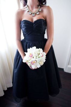 such a fan of a statement necklace on a strapless bridesmaid dress