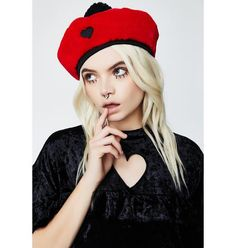 Lazy Oaf Red Fur Beret got ya lookin' cute af! This fuzzy red beret has a black pom-pom on top, a black trim band, and a black heart on the front.