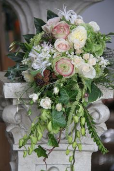 Love the draping leaves    berries roses wedding bouquet spray hydrangea jasmine vine ivy cascade