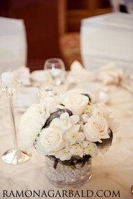 Love this lush, low centrepiece all in white with black accents. Adore the pearls in the base of the vase! #wedding #centrepiece #flowers #decor
