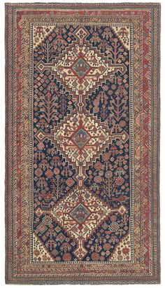QASHQAI, Southwest Persian, 4ft 10in x 8ft 7in, Late 19th Century. Exceptionally nimble floral patterning surrounds a trio of graceful, linked medallions in this strongly collectible example of cherished antique Qashqai tribal weaving.