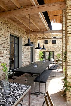 stone and wood with the black trim, lighting & table/benches