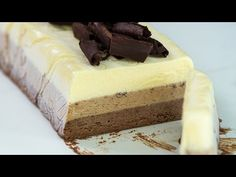 Triple Chocolate Semifreddo - beautifully layered dessert, creamy and chocolaty, not too sweet, with bites of crunchy chocolate curls, by far one of the best treats for summer days. Great Desserts, Köstliche Desserts, Frozen Desserts, Sweet Recipes, Cake Recipes, Snack Recipes, Dessert Recipes, Chocolate Biscuit Cake, Tres Chocolates