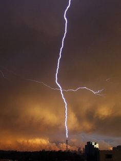 Lightning strikes the Hillbrow Telkom Tower in Johannesburg, South Africa. Tall towers are frequent targets of lightning strikes, because there is less air to act as an insulator between the tower and a cloud.