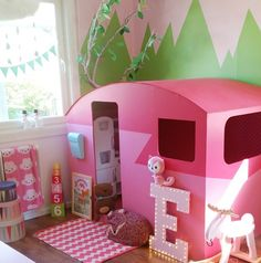 A pink retro happy camper as an indoor playhouse in the kids room,girls room, boys room. Forest nursery, camping kids room. ikea bråkig, marquee ligts. Pink chevron rug, painted wall