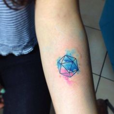 Watercolor icosahedron tattoo on the left inner forearm. Tattoo...