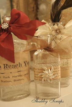 Embellished bottles for Christmas. Perfect use for my glitter ribbon!!