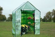 """Green Garden House Walk in Greenhouse Hot 56""""x56""""x77""""-GH007 by WPIC-Store. $69.99. A handy greenhouse for starting seeds, the Mini Greenhouse is lightweight and easy to assemble. It's constructed with a sturdy steel frame and a removable clear PVC plastic canopy. The zippered door rolls up for easy access. This mini greenhouse can go just about anywhere - patio, balcony, deck, garden, or lawn. It measures (++++++++++).   What's included?  Greenhouse ..."""