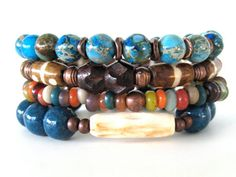 Bright and colorful beaded stretch bracelets featuring 10mm aqua limestone beads, multi-colored glass beads, antiqued bronze beads, 8mm web jasper beads and Kenya batik bone tube beads. An awesome bracelet stack that can be worn as shown or individually for a more simple statement. The array of colors in this stack will blend seamlessly with just about any outfit making this a very versatile set.
