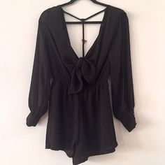 LF Open Back Romper Black LF x Paper Heart open back romper. Ties in the front and is open in the back with a strip of gold embellishments. Long sleeve with slits in the sleeves. Gold buttons on sleeves. Such a cute romper and super comfortable! Great condition! LF Pants Jumpsuits & Rompers