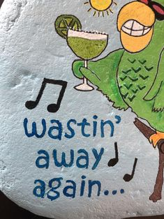 Hand painted on a large textured River rock are some of the song lyrics to Margaritaville. Wastin away again as a parrot sits on his perch holding a margarita. I even trimmed the glass with some painted salt! Rock Artists, Great Artists, Pool Shed, Painted Rocks, Hand Painted, Patio Signs, Best Rock, Paint Pens, Fourth Of July